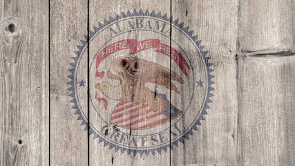 USA Politics News Concept: US State Alabama Seal Wooden Fence Background