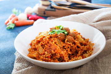 Radiatori pasta Bolognese on the table