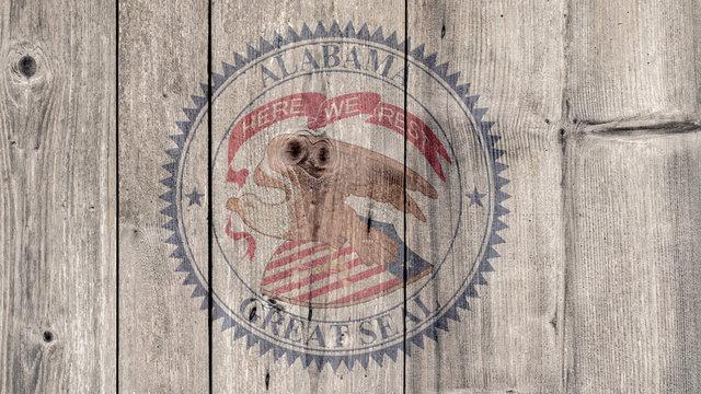 USA Politics News Concept: US State Alabama Seal Wooden Fence Background