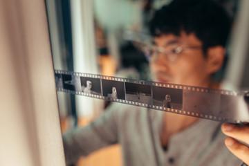 Photographer checking 35mm filmstrip