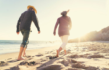 Couple walking on the beach on a sunny day