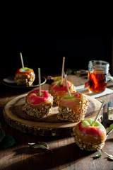 Caramel Apples on a Rustic Farmhouse Table next to a Window