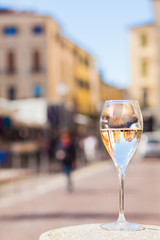 Glass of chilled prosecco on Padova streets background