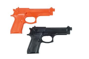 black and orange plastic toy pistols white background