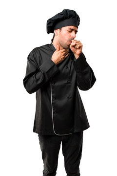 Chef man In black uniform is suffering with cough and feeling bad on isolated white background