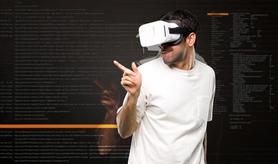Man using VR glasses enjoy dancing inside the virtual reality mode