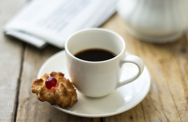 Sweet homemade cookies and cup of coffee on the table, selective focus and copy space