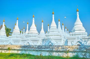 The white stupas of Kuthodaw Pagoda in Mandalay, Myanmar