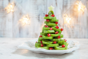 Kiwi pomegranate Christmas tree, beautiful New Year background