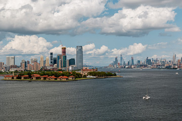New York City / USA - AUG 22 2018: Ellis Island and midtown Manhattan skyscrapers view from the Statue of Liberty