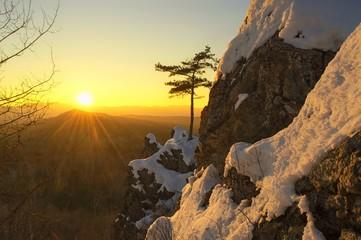 Winter sunset in the mountains. Bolshekhekhtsirsky Nature Reserve.  Khabarovsk region, far East, Russia.