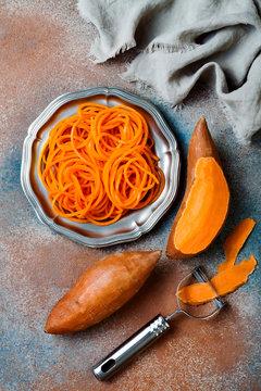 Spiralized sweet potato spaghetti. Low carb vegetable pasta cooking