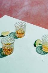 Three tequila shots with lime