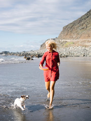 Woman enjoying frisbee with dog