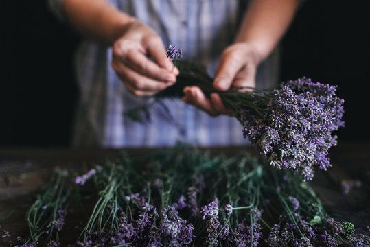 Woman arranging lavender bouquet