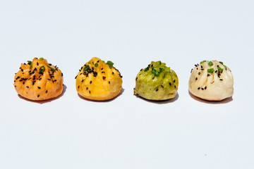 Bao dumplings on white background