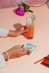 Woman paying for greyhound cocktail