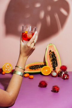 Hand of woman holding Negroni cocktail