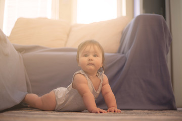 Baby in living room.