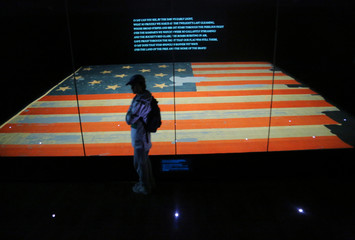 "A boy views the flag known as ""The Star Spangled Banner"" in Washington"