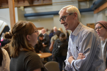 Democratic gubernatorial candidate Tony Evers speaks to a supporter at a campaign event in Beloit, Wisconsin