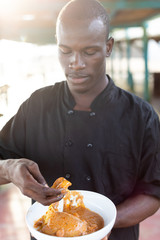 Man eating fufu and soup