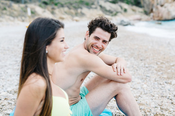 Laughing couple spending time on beach