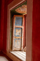 Window panel in a red room