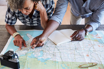 Senior African American Couple planning a trip in retirement