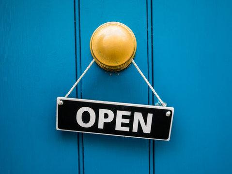 Blue shop door with open sign