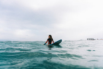 Girl surfing in water