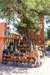 A marketplace with dishes and ceramics