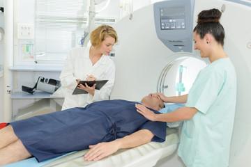 nurse adjusting patients face before mri scan