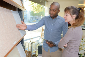 Man showing display of tiles to customer