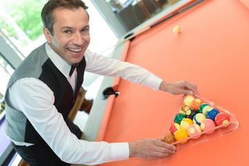 businessman holding billiard balls
