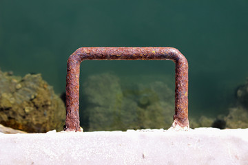 Old rusty dock cleat detail horizontal