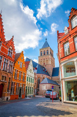 Church of Saint Giles and traditional narrow streets in Bruges (Brugge), Belgium