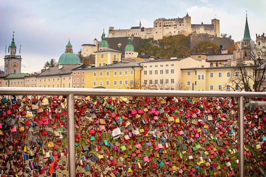 Salzburg cityscape view from Makartsteg bridge. Love locks at Makartsteg bridge on Salzach river and view to the fortress.