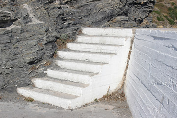 White concrete stairs incorporated into rock