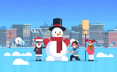 mix race children making snowman merry christmas happy new year holiday cityscape background flat horizontal vector illustration