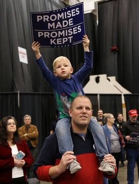 Supporters of U.S. President Donald Trump gather at his rally in support of Republican candidates on the eve of the U.S. midterm election in Cleveland, Ohio