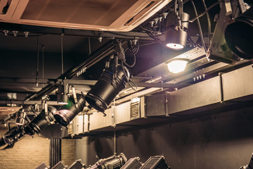 Modern stage theater floodlights and projector illumination equipment - fototapety na wymiar