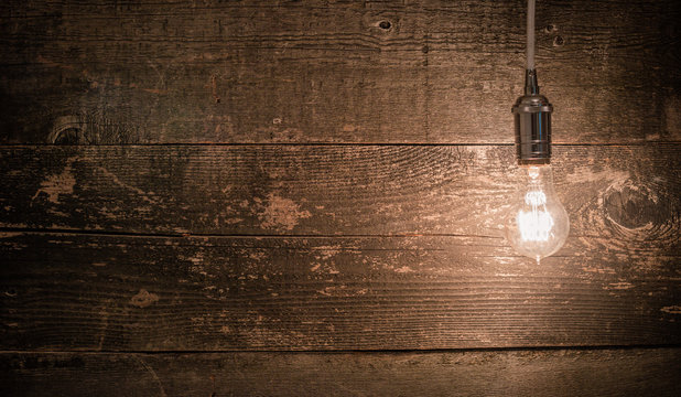 edison vintage light bulb right landscape view with barn wood background