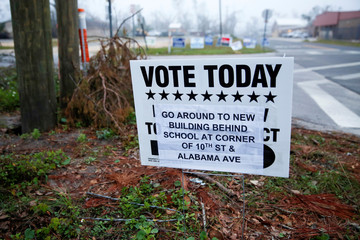 A sign directs voters to a new polling location where Hurricane Michael destroyed many schools and other buildings used as polling stations in the area in Lynn Haven