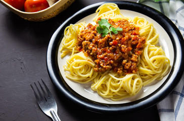 delicious homemade plate of spaghetti on black board