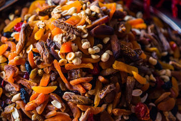 Dried fruit mix on the market. Colored dried fruit in the store. Juicy and sweet snack of nuts. Famous oriental traditional sweetness delight
