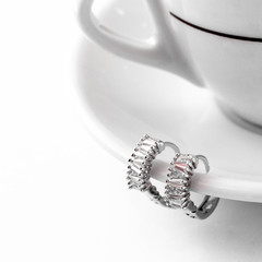 Round stud earrings on rhe cup
