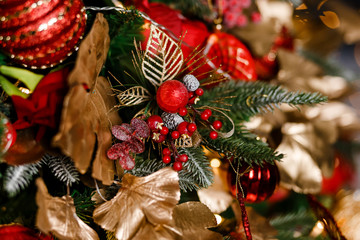 Christmas tree branch decorated with red berries