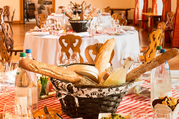 decorated table setup with baguettes and french food