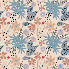 Seamless tropical pattern . Palm leaves, flowers on a beige background.